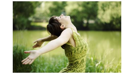 woman-dancing-outside-green-dress