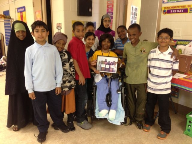 Essex Village students with Teresa